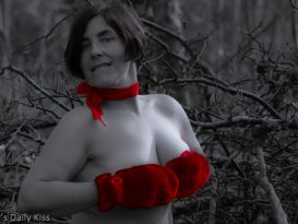 Naked in the woods wearing red scarf and gloves