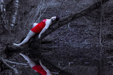 Red lingerie reflected in pond