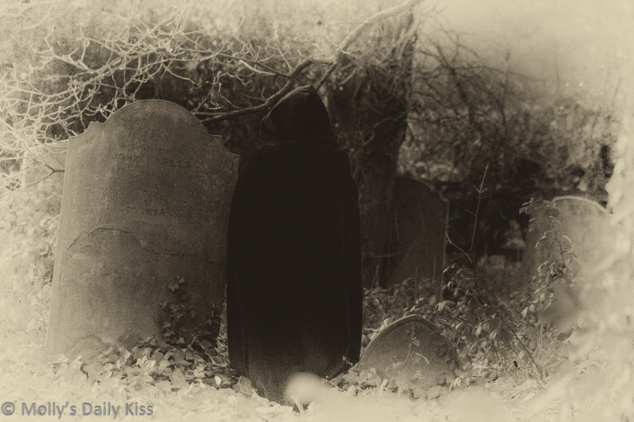 Ghostly figure haunting graveyard