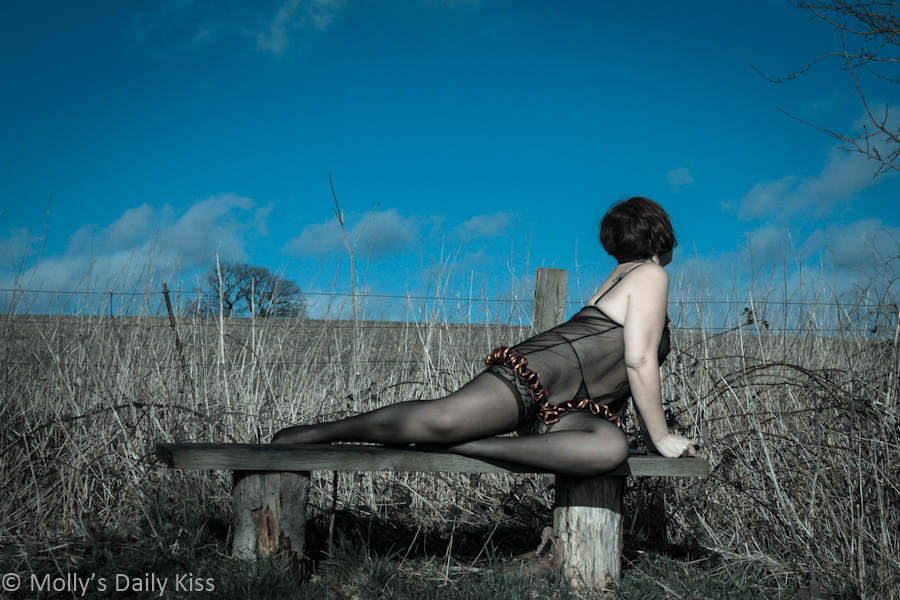 Woman in lingerie against bright blue sky