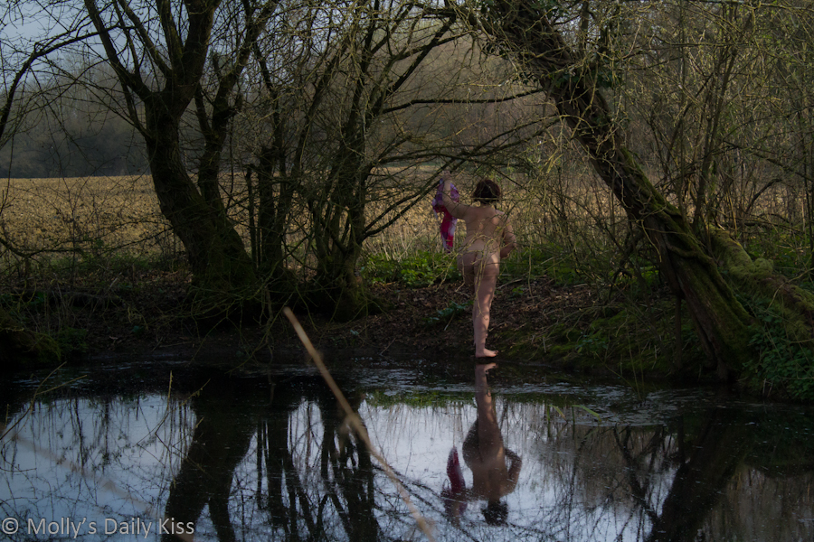naked by woodland pond