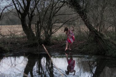 Dipping toe in winter pond