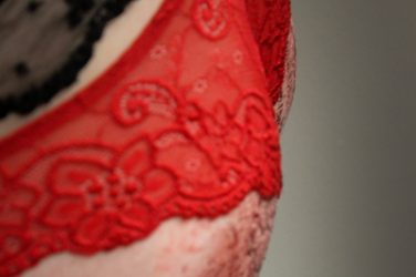 Bloody red bottom and fishnet stockings