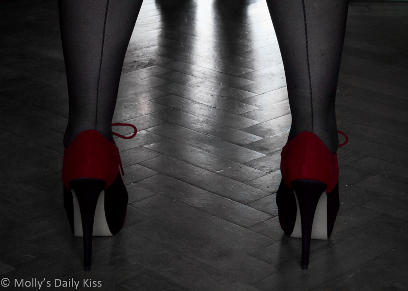 Red high heels & seemed stockings for interview