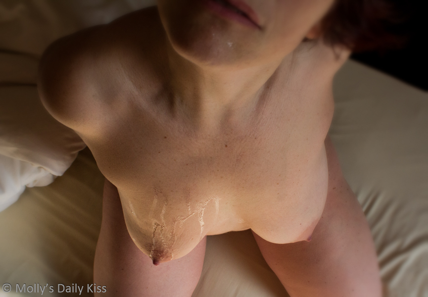 Cum on Molly's breasts