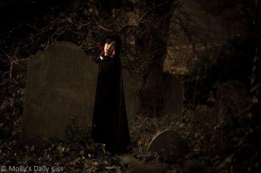 Ghostly woman in graveyard