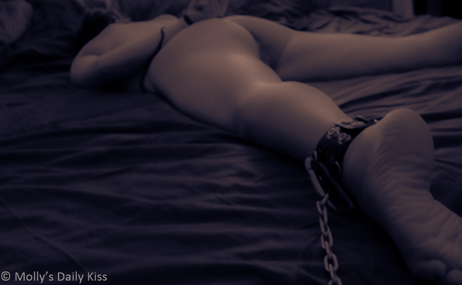 Cuffed to the bed with legs spread