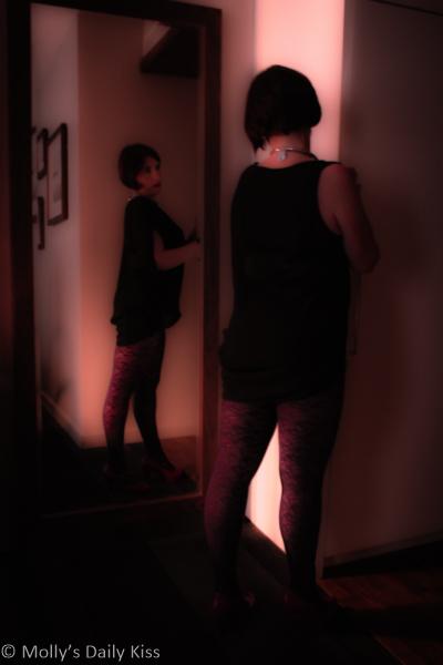Self portrait in mirror in red room