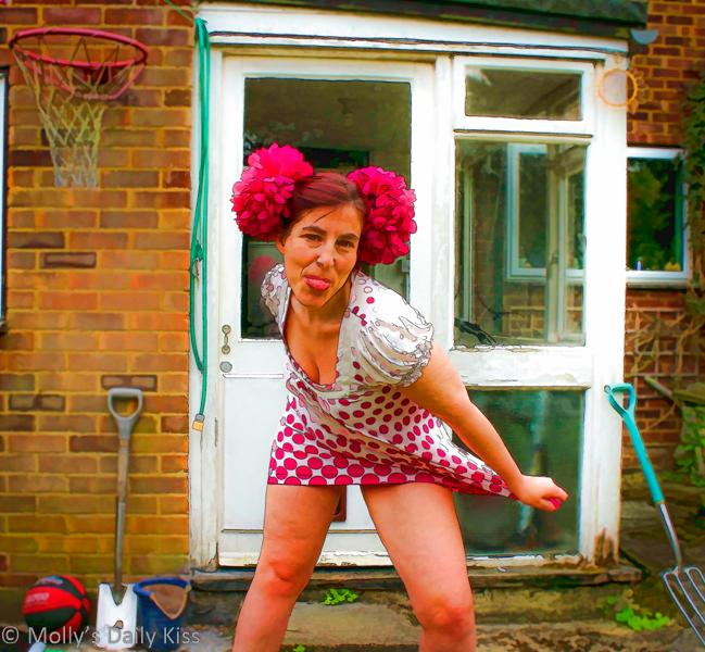 Molly in polka dot dress poking out tongue