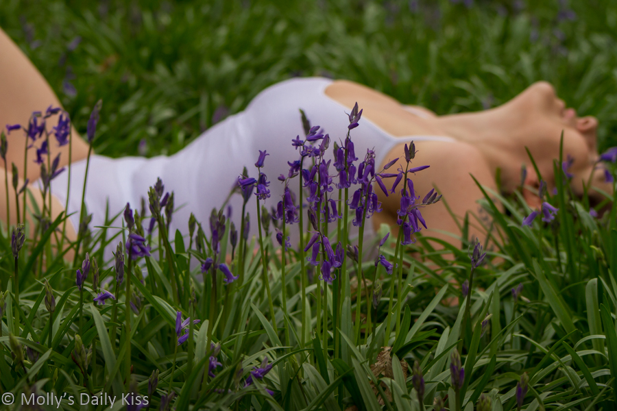 Laying in bluebells masturbating