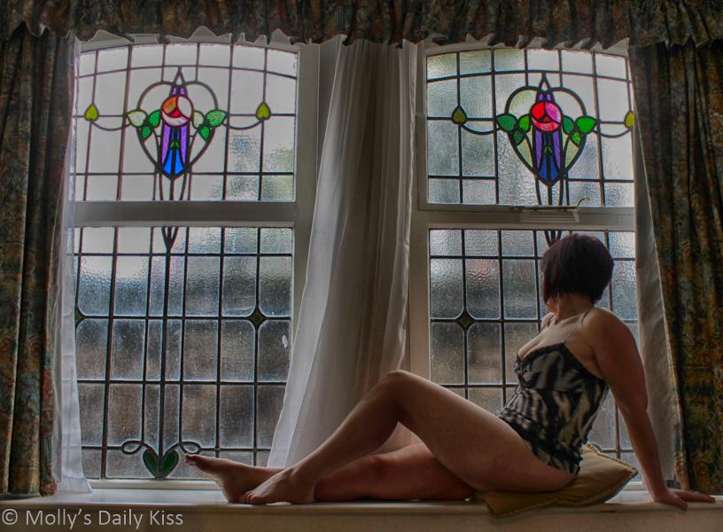 Molly sitting in hotel room window