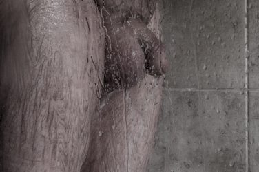 Naked man in the shower