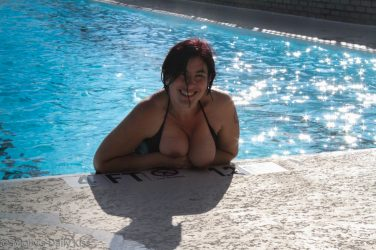 Topless in hotel rooftop pool
