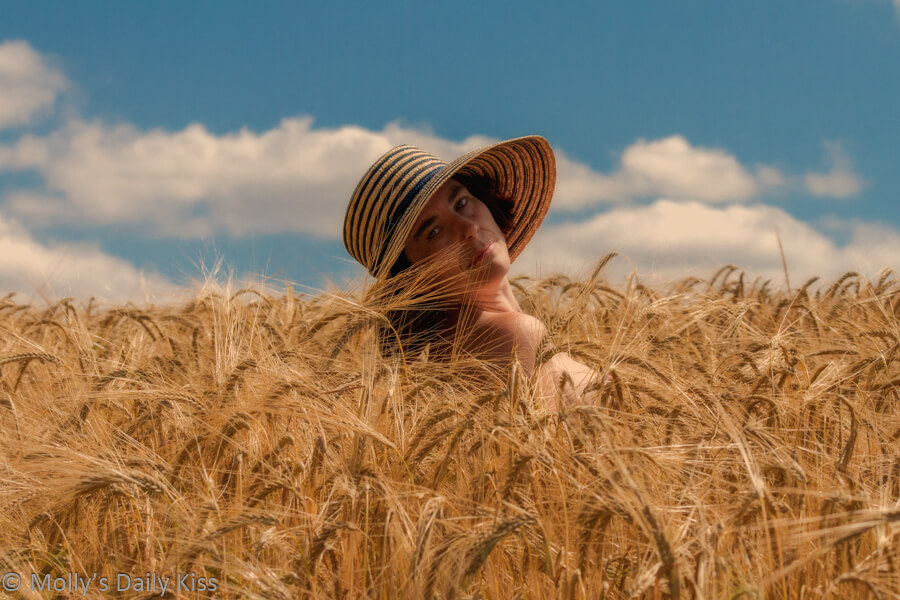 Molly in a field of wheat