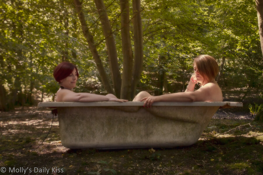 Molly and Exposing 40 sitting in old bathtub in the woods naked
