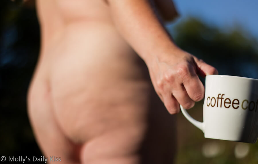 Enjoying cup of coffee naked in the garden