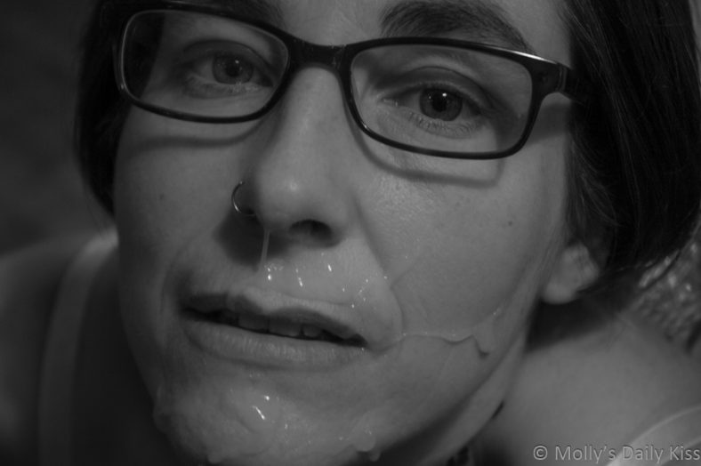 Molly with face full of cum on her face