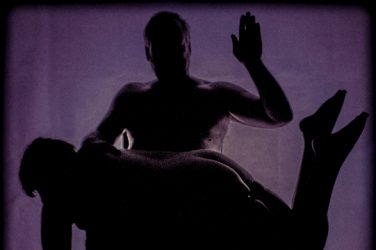 Molly Over Michaels knee silhouette of spanking
