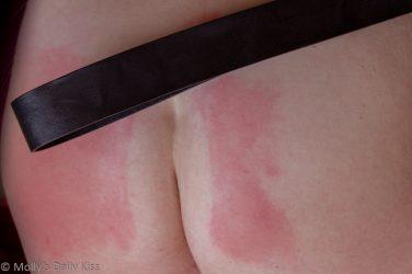 Red belt marks on Molly's bottom