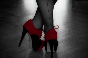 red and black high heels with seemed stocking