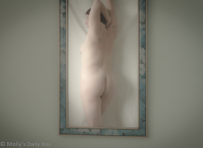 Reflection of Molly nude in mirror