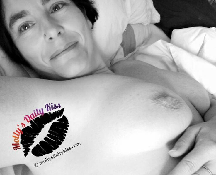 Molly laying in bed topless black and white free the nipples