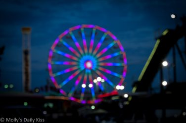 Ferris wheel at night. The cure for heights is a kiss