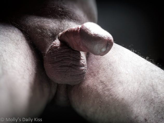 Cock shot taken from below with semen coming out