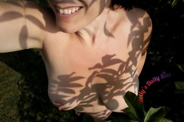 Molly naked in the garden with shadow leaves on her skin, visable result of the day