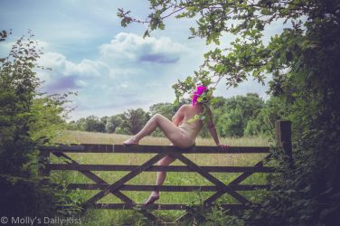 Molly sitting on gate nude beauty