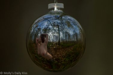 Molly naked in the woods reflection in christmas bauble