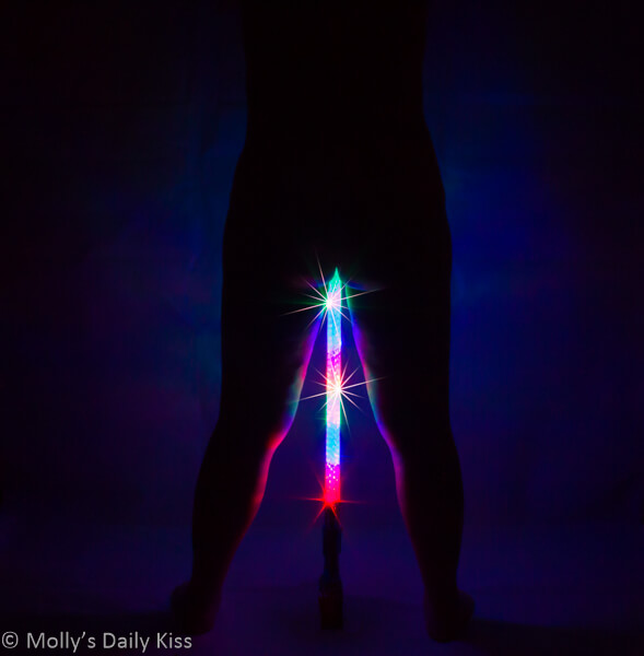 Silhouette of Molly with light saber between her legs. The Force Awakens
