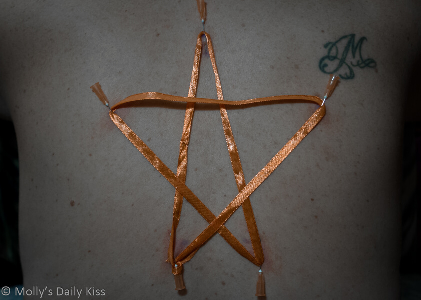 Star shaped ribbon needle play on back