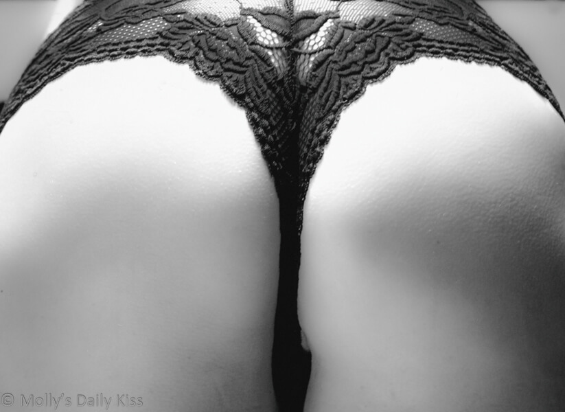 Black and white picture of mollys bum with black lace panties