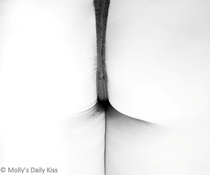 High key image of mollys bottom with thong along her bum crack. Beautiful simplicity