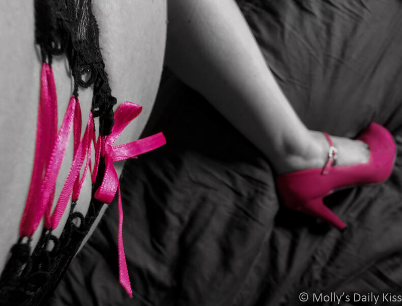 Pink ribbon on mollys panties with view down her leg to her pink high heels. Classy and fabulous