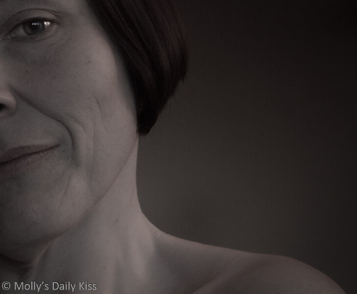 Face portrait of molly that shows half her face and bare shoulder. No matter what.