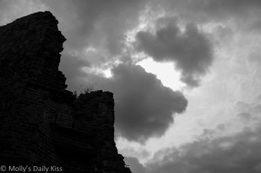 thunder storm clouds over ruins