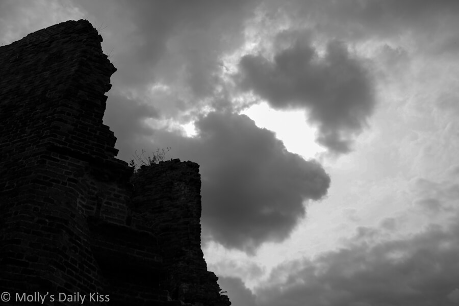 storm clouds over ruins