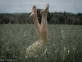 Picture of Molly in long grass with her feet up in the air