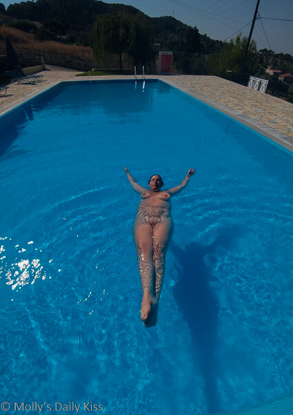 Molly naked in swimming pool