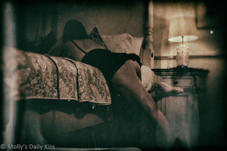 molly laying over bed with dirtier wet plate edit