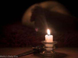 candle and knife on ground with molly laying naked in the background