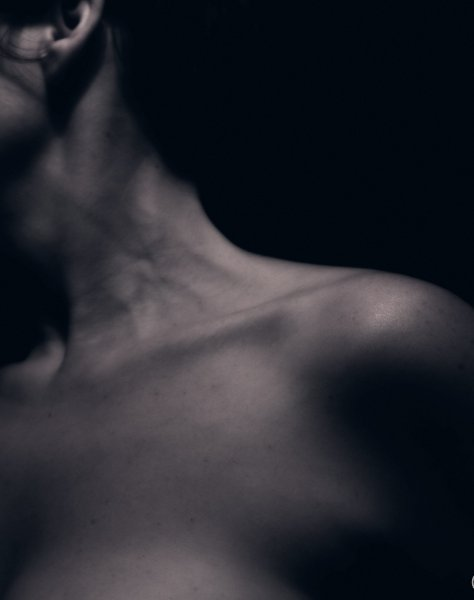 Black and white shot of mollys neck and shoulder showing the veins in her neck