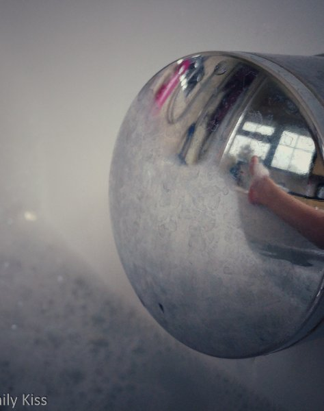 molly reflected in bath tap