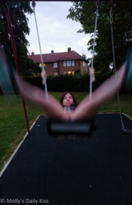 MOlly on the swing with her legs spread not wearing any knickers