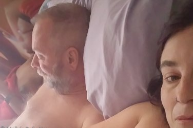 Cara, Michael and Molly laying in bed together