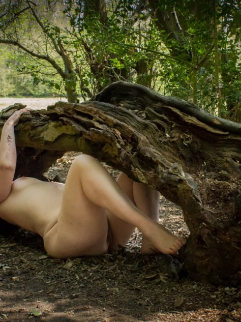 Molly Laying naked underneath fallen tree stump. For a post called I am Wild