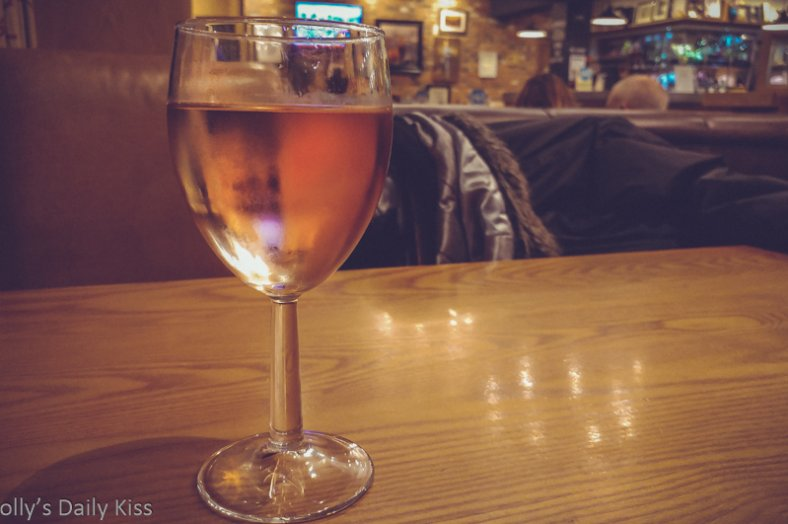 Glass of wine on the table in a pub for a post called body language about a hook up