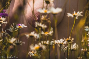 Molly topless in the dainty blooms of wild flowers